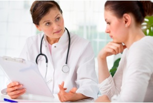Feritity doctor talking to patient about PCOS
